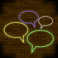 Colorful Speech Bubbles on Brick Background
