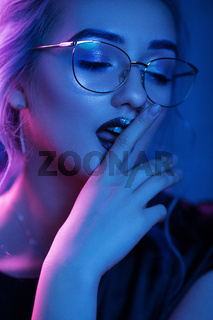 Sexy woman in glasses with vamp makeup