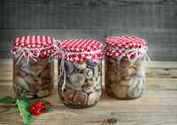 Home canning: marinated mushrooms in glass jars
