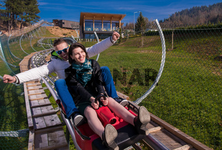 couple driving on alpine coaster