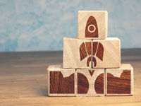 Wooden pyramid with an abstract rocket