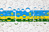 Water drops on glass and flags of Rwanda