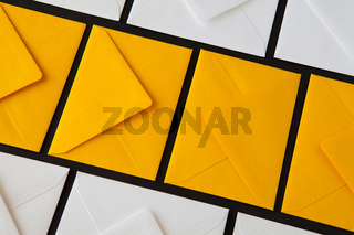 Composition with white and yellow, envelopes on the table.