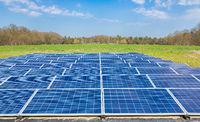 Dutch landscape with blue solar panels field