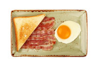 Close up egg, toast and bacon on plate