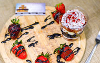 Sweet English Trifle Dessert with blueberry cream and strawberries.