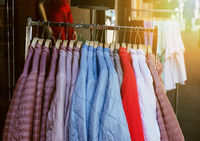 clothes rack with ladieswear spring fashion jackets hanging outside store