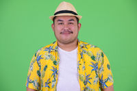 Face of young overweight Asian tourist man