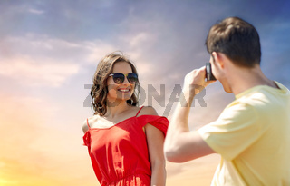 happy couple with camera photographing