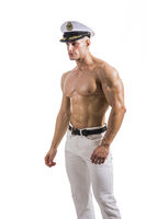 Muscular shirtless male sailor with navy hat