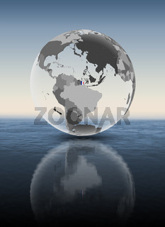 French Guiana on translucent globe above water