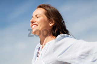 happy smiling woman enjoying sun