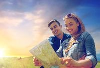 happy couple with map outdoors