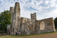 tourists visit the ruins of the old abbey and Benedictine monastery at Jumieges in Normandy in France
