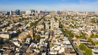 Wide Aerial Perspective over Streets and Neighborhoods of Baltimore Maryland