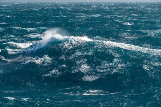 Modern cruise ship traveling through rough seas