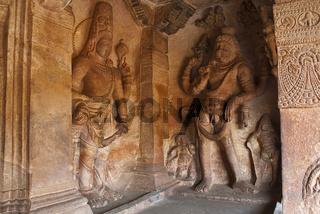 Cave 3 : Carved figure of Vishnu as Narasimha, half human, half lion, on the right and Harihara, a syncretic sculpture of Vishnu and Shiva, on the left Badami Caves, Karnataka, India.