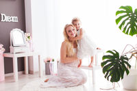 Mom with her daughter together in the room
