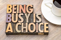 being busy is a choice - word abstract in wood type