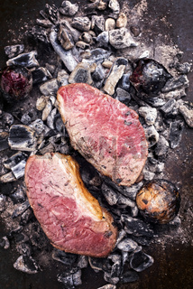 Barbecue caveman wagyu roast beef as top view on charcoal