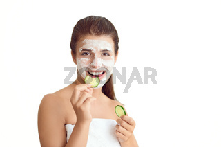 Smiling young woman wearing a face mask