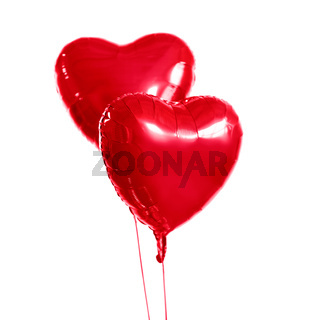two red heart shaped helium balloons