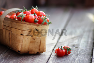 rustic basket of tomato fresh on wood