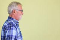 Closeup profile view of senior bearded hipster man