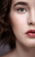 Closeup beauty portrait of young woman. Brunette girl with day nude female face makeup