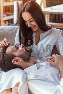 Charming lovestory of beautiful couple indoors.