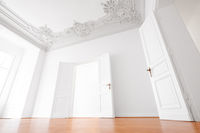 empty room  in luxury apartment flat with wooden floor and stucco ceiling