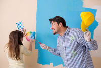 The husband and wife doing renovation at home