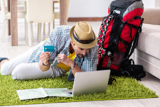 Young man planning his travel online