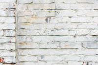 Old whitewashed brick wall, cracked and dirty. White color design background