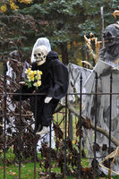 Boston, Massachusetts, USA – October 21, 2009: skeletons and pumpkins decorated ordinary houses for Halloween in New England