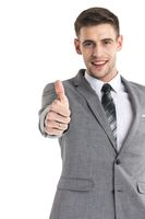 Happy businessman thumbs up sign