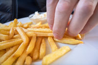 Grabbing some French fries