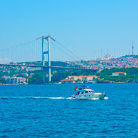 The Bosphorus Bridge and motorboat