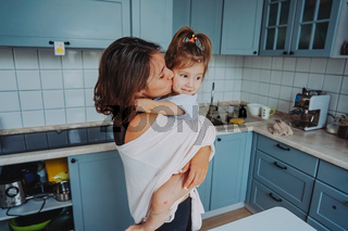 Mom and little daughter having fun together