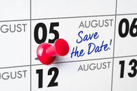Wall calendar with a red pin - August 05