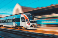 High speed train in motion at the railway station. Railroad