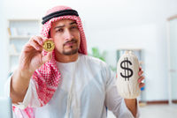 Arab man with bitcoin in cryptocurrency mining concept