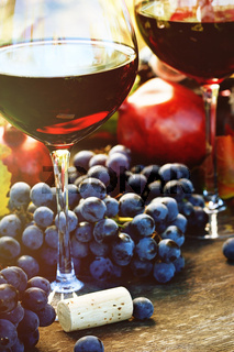 Closeup of glasses of red wine and grapes