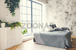 Modern bedroom with grey pillows