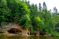 Landscape with river, cliff  and forest in Latvia.