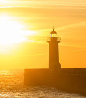 Lighthouse at sunset. Porto, Portugal