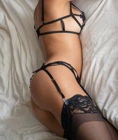 Closeup body of model in lingerie indoors