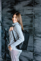 Fashionable woman hold black bag