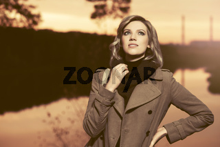 Happy young fashion blond woman walking outdoor