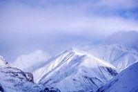Winter snow covered mountain region of peak Kazbegi in Caucasus mountains.